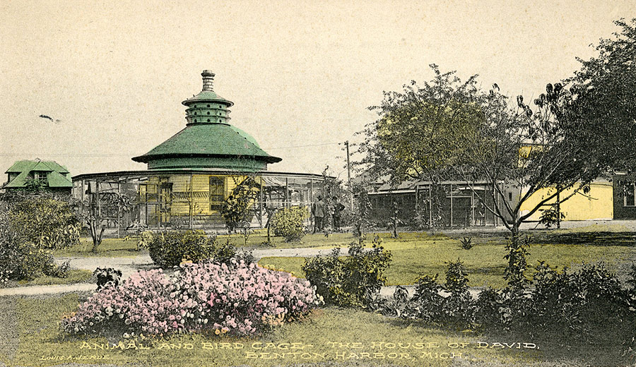 A small park consisting of landscaped grounds, a zoo and this round aviary were built to the west of the ice cream parlor. Together they served as the first version of the House of David's soon-to-be famous amusement park. The aviary was later used as the leather cobbler shop. The structure behind the aviary on the left is the first of many log cabins that would grace the House of David grounds.