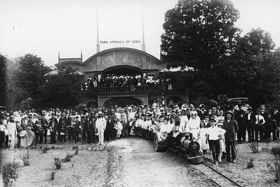 Eden Springs Park opened for the 1908 season. Here Brother Benjamin and many of the faithful gather along with non-members to celebrate the park's grand opening. The Archway stands behind them.