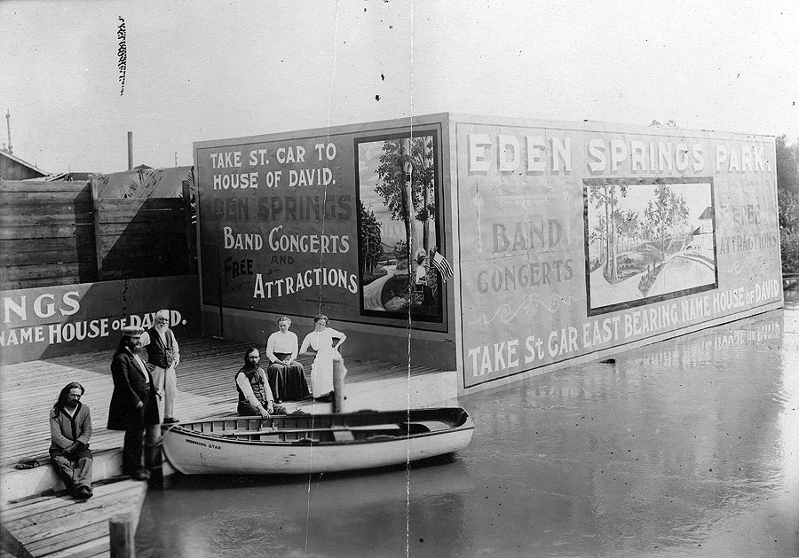 This early advertisement on St. Joseph's waterfront encouraged passengers of the many steamships that came across the lake from Chicago to take the street car lines to the park. St. Joseph and Benton Harbor had a long history of being a popular weekend destination for Chicagoans, and Eden Springs Park added to the attraction. Brother Benjamin is visible along with several colony members. The small boat, the Morning Star, was built at the House of David.