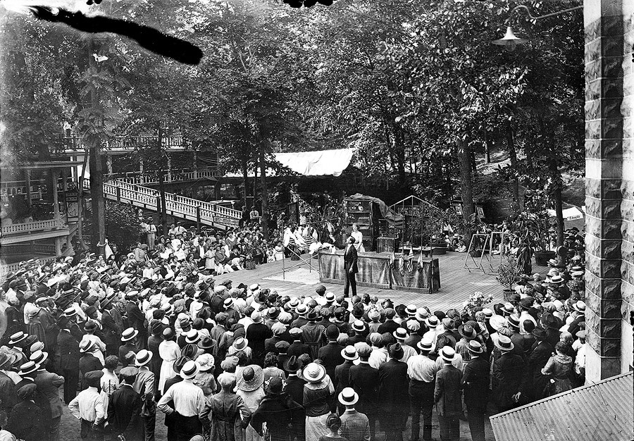 In addition to acts provided by colony members, the House of David brought in various acts from the outside world. This photograph shows a crowd enthralled by an exotic bird show.