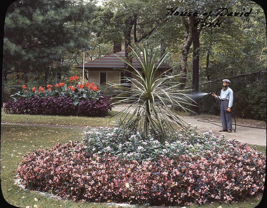 Eden Spring's beautiful landscaped grounds were one of its original and most popular attractions. The exotic plants were tended by various colony members with much of the work done by Dominick Zitella, seen here in this mid-1940s view. The top floor of the Beer Garden and the original wood footbridge are visible in the background.