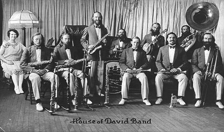 By the early 1920's popular music in the United States was undergoing a Jazz revolution.  It appears that the twenty-piece House of David road band was playing Jazz no later than 1919.  Late in 1920 the band reorganized as two ten piece bands to focus exclusively on playing Jazz.  Gone were the big brass band and the marches.  This new arrangement usually consisted of two coronets, two saxophones, two trombones, a tuba, a banjo, a piano and drums.  It was optimized for playing early Jazz, now known as ''Classic'' or ''Hot'' Jazz.