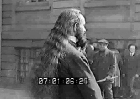 Band member Frank Rossetta, shows the biggest novelty of the House of David Band - long hair and beards.  From 1910 through the 1920s when the road bands were active, the popular style for the rest of the US population, was short hair and shaved faces.