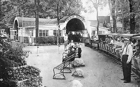The south depot was the arrival point for most visitors to the park.  The depot was ringed by cottages, a baseball park, zoo, restaurant and hotel.  Inside the depot were souvenir stands and an ice cream parlor.  On the east side of the depot was a hopper and water tank for the replenishment of coal and water for the miniature engines.  Once refueled the trains would depart on their return trip through the zoo, over the east trestle, past more tourist cabins and the Diamond House to the north depot on Britain Ave.  Update: As it appeared in 2001.