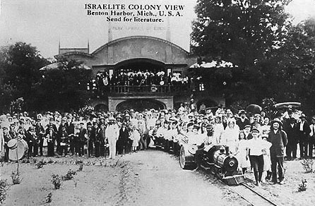 This is how Eden Springs Park looked like on opening day in July 1908.  The official opening of the park was in August of that year.  This photo is similar to one captioned in a newspaper article of the time as on the park's opening day.  It was probably taken on that same day.  In this photo the tracks in the foreground are not angled further to the right as in the early ''D'' track configuration.  The track in this image probably shows the southern end of the earliest track layout. This point to point track ran north from the Archway building crossing Britain Ave as shown in photos #17 & #18.  It then ran under the 1906 Arch between the Bethlehem and Jerusalem residential buildings and then continued to (or through) the arch on the east side of the original ice cream parlor further north.  This layout was short lived because it was not practical for moving people to and from the park.
