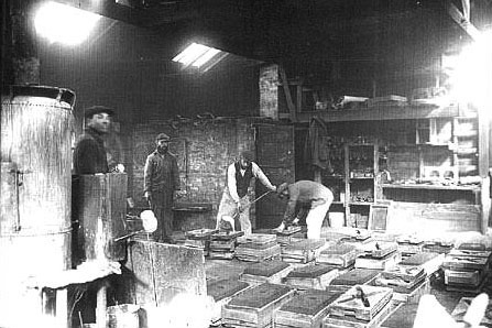 In the early years the House of David operated a foundry.  Here they cast many different articles used at the colony including parts for the miniature trains.  Along with articles such as stove parts and manhole covers the colonists cast parts for the trains including fire box grates, cylinders, pistons, wheels and smoke box rings.  The man at the far left in this foundry picture is John Tucker the famous House of David baseball player.  In this egalitarian society even well known members worked at less glamorous jobs for the good of all.  Industry was encouraged and during seasonal work peaks on the farms colony sports figures, musicians and leaders could be found side by side with the rank a file members in the fields.